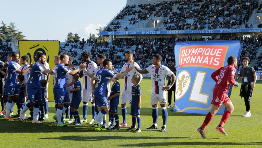 Lyon's players shake hands with Bastia's players before the L1 football match Bastia (SCB) against Lyon (OL) on April 16, 2017 in the Armand Cesari stadium in Bastia on the French Mediterranean island of Corsica. Bastia's home game against Lyon in French Ligue 1 was abandoned after fans of the Corsican side attacked the visiting players before the game and at half time on April 16. 'Following the new incident at the end of the first period, the LFP decided to definitively stop the game between Bastia and Lyon,' the French professional football league (LFP) said in a statement.  / AFP PHOTO / PASCAL POCHARD-CASABIANCA        (Photo credit should read PASCAL POCHARD-CASABIANCA/AFP/Getty Images)
