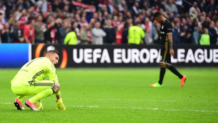 Lyon's Portuguese goalkeeper Anthony Lopes reacts after the UEFA Europa League semi-final, first leg, Ajax Amsterdam v Olympique Lyonnais (OL) on May 3, 2017 in Amsterdam.  / AFP PHOTO / Emmanuel DUNAND        (Photo credit should read EMMANUEL DUNAND/AFP/Getty Images)