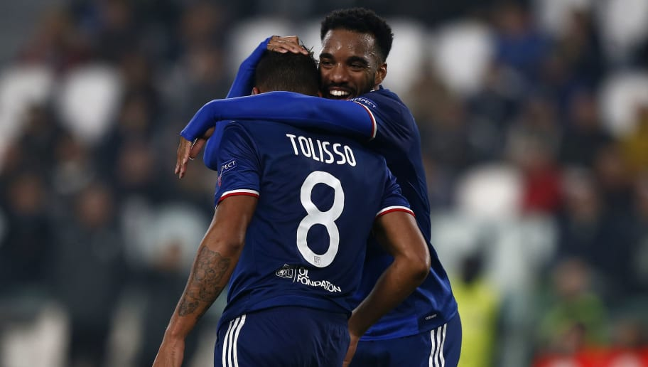 Lyon's French midfielder Corentin Tolisso (L) is congratulated by teammate Lyon's French forward Alexandre Lacazette after scoring a goal during the UEFA Champions League football match Juventus vs Olympique Lyonnais on November 2, 2016 at the Juventus stadium in Turin.  / AFP / MARCO BERTORELLO        (Photo credit should read MARCO BERTORELLO/AFP/Getty Images)