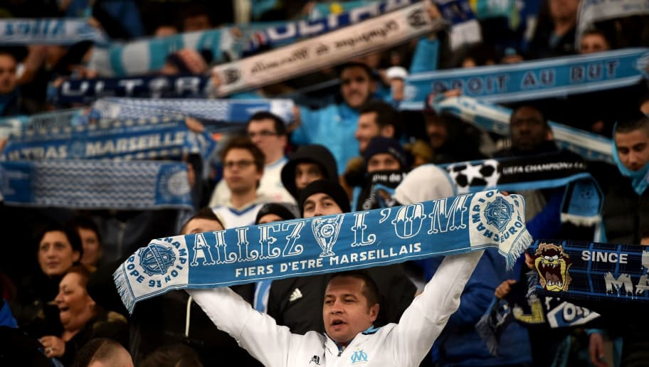 Marseille's supporters hold banners during the French L1 football match between Marseille (OM) vs Montpellier (MHSC) at the Velodrome Stadium in Marseille, southern France, on January 27, 2017. / AFP PHOTO / ANNE-CHRISTINE POUJOULAT        (Photo credit should read ANNE-CHRISTINE POUJOULAT/AFP/Getty Images)