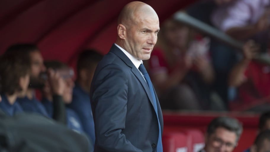 Real Madrid's French coach Zinedine Zidane looks on before the Spanish league football match Granada FC vs Real Madrid CF at Nuevo Los Carmenes stadium in Granada on May 6, 2017. / AFP PHOTO / SERGIO CAMACHO        (Photo credit should read SERGIO CAMACHO/AFP/Getty Images)