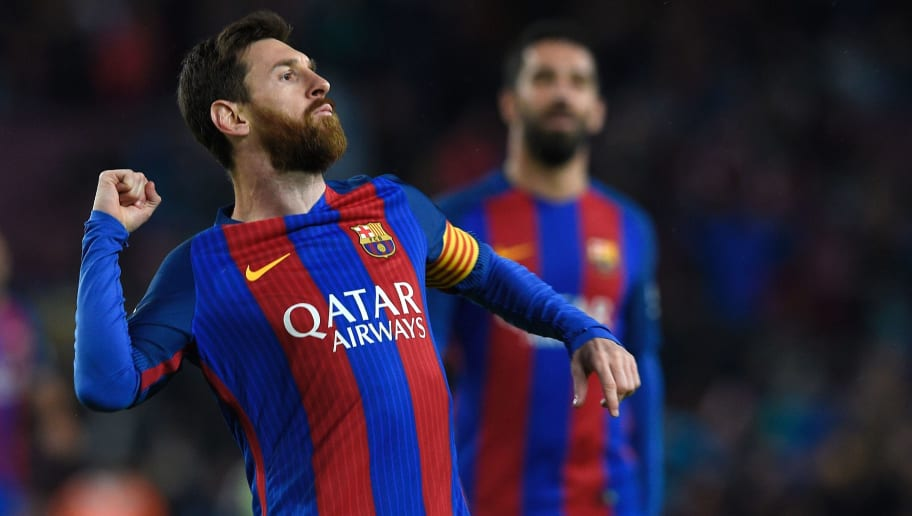 Barcelona's Argentinian forward Lionel Messi celebrates after scoring a goal during the Spanish league football match FC Barcelona vs CA Osasuna at the Camp Nou stadium in Barcelona on April 26, 2017. / AFP PHOTO / LLUIS GENE        (Photo credit should read LLUIS GENE/AFP/Getty Images)