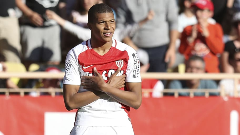 Monaco's French forward Kylian Mbappe Lottin celebrates after scoring a goal during the French L1 football match Monaco (ASM) vs Toulouse (TFC) on April 29, 2017 at the 'Louis II Stadium' in Monaco.   / AFP PHOTO / VALERY HACHE        (Photo credit should read VALERY HACHE/AFP/Getty Images)