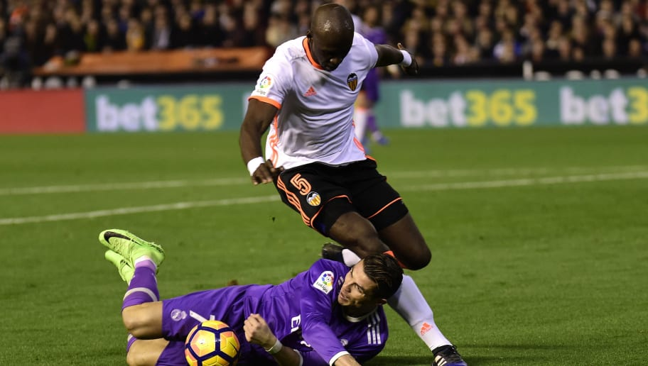 Real Madrid's Portuguese forward Cristiano Ronaldo (L) vies with Valencia's French defender Eliaquim Mangala  during the Spanish league football match Valencia CF vs Real Madrid CF at the Mestalla stadium in Valencia on February 22, 2017. / AFP / JOSE JORDAN        (Photo credit should read JOSE JORDAN/AFP/Getty Images)