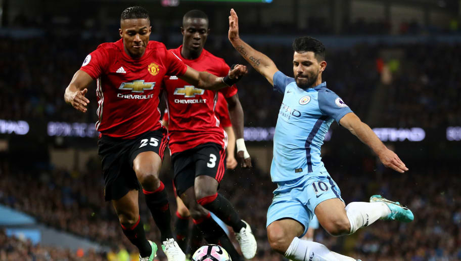 MANCHESTER, ENGLAND - APRIL 27:  Antonio Valencia of Manchester United puts pressure on Sergio Aguero of Manchester City during the Premier League match between Manchester City and Manchester United at Etihad Stadium on April 27, 2017 in Manchester, England.  (Photo by Clive Brunskill/Getty Images)