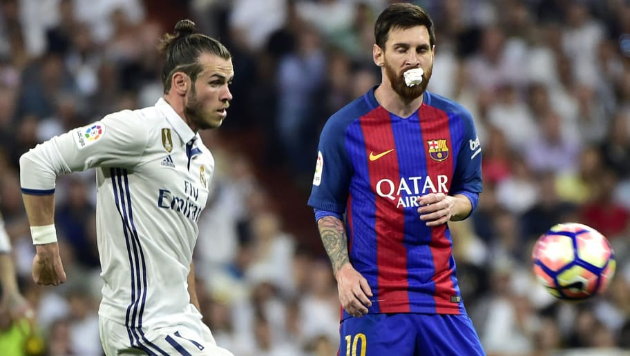 Real Madrid's Welsh forward Gareth Bale (L) vies wit Barcelona's Argentinian forward Lionel Messi during the Spanish league football match Real Madrid CF vs FC Barcelona at the Santiago Bernabeu stadium in Madrid on April 23, 2017. / AFP PHOTO / GERARD JULIEN        (Photo credit should read GERARD JULIEN/AFP/Getty Images)