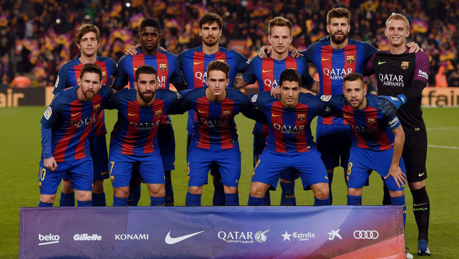 (From left) Barcelona's players; (back row) midfielder Sergi Roberto, French defender Samuel Umtiti, Portuguese midfielder Andre Gomes, Croatian midfielder Ivan Rakitic, defender Gerard Pique, German goalkeeper Marc-Andre Ter Stegen and (front row) Argentinian forward Lionel Messi, Turkish midfielder Arda Turan, midfielder Denis Suarez, Uruguayan forward Luis Suarez and defender Jordi Alba pose before pose before the Spanish Copa del Rey (King's Cup) semi final second leg football match FC Barcelona vs Club Atletico de Madrid at the Camp Nou stadium in Barcelona on February 7, 2017. / AFP / LLUIS GENE        (Photo credit should read LLUIS GENE/AFP/Getty Images)