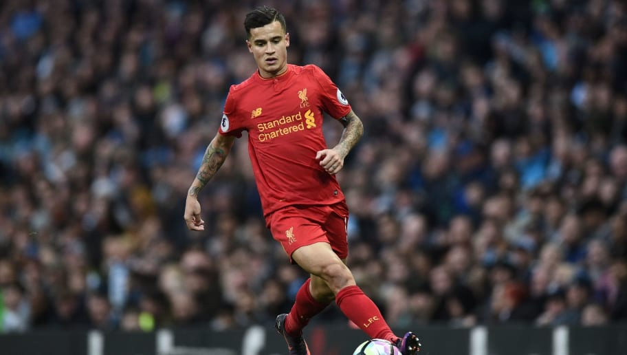 Liverpool's Brazilian midfielder Philippe Coutinho runs with the ball during the English Premier League football match between Manchester City and Liverpool at the Etihad Stadium in Manchester, north west England, on March 19, 2017. / AFP PHOTO / Oli SCARFF / RESTRICTED TO EDITORIAL USE. No use with unauthorized audio, video, data, fixture lists, club/league logos or 'live' services. Online in-match use limited to 75 images, no video emulation. No use in betting, games or single club/league/player publications.  /         (Photo credit should read OLI SCARFF/AFP/Getty Images)