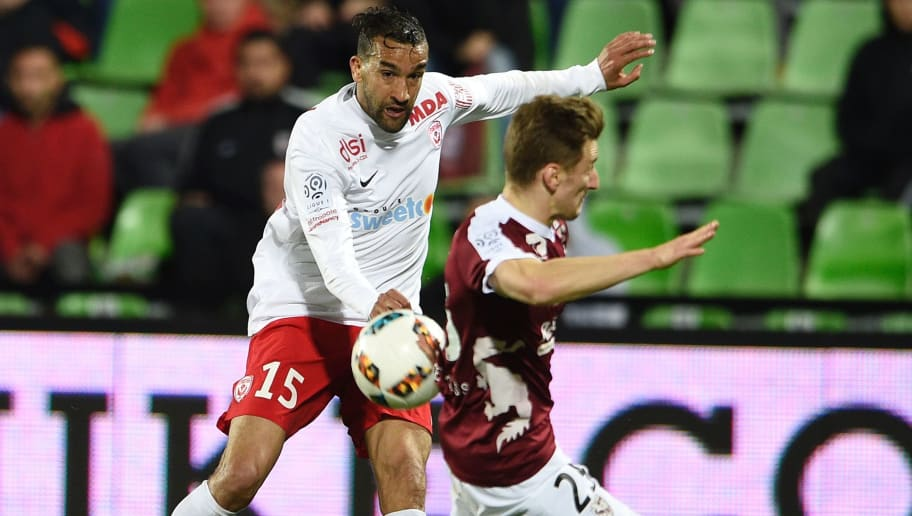 Metz' Spanish defender Ivan Balliu (R) vies for the ball with Nancy's Morrocan forward Youssouf Hadji   during the French L1 football match between Metz (FCM) and Nancy (ASNL) on April 29, 2017 at the Saint-Symphorien stadium in Metz. / AFP PHOTO / Jean Christophe VERHAEGEN        (Photo credit should read JEAN CHRISTOPHE VERHAEGEN/AFP/Getty Images)