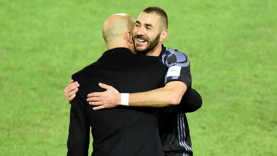 Real Madrid's forward Karim Benzema (R) is congratulated by head coach Zinedine Zidane (back) after scoring a goal during the Club World Cup semi-final football match between Club America of Mexico and Real Madrid of Spain at Yokohama International stadium in Yokohama on December 15, 2016. / AFP / TORU YAMANAKA        (Photo credit should read TORU YAMANAKA/AFP/Getty Images)
