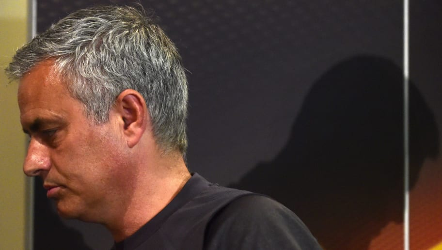 Manchester United's Portuguese manager Jose Mourinho leaves the press room after attending a press conference at Old Trafford in Manchester, north west England on May 10, 2017, ahead of their UEFA Europa League semi-final second leg football match against Celta Vigo. / AFP PHOTO / Miguel RIOPA        (Photo credit should read MIGUEL RIOPA/AFP/Getty Images)
