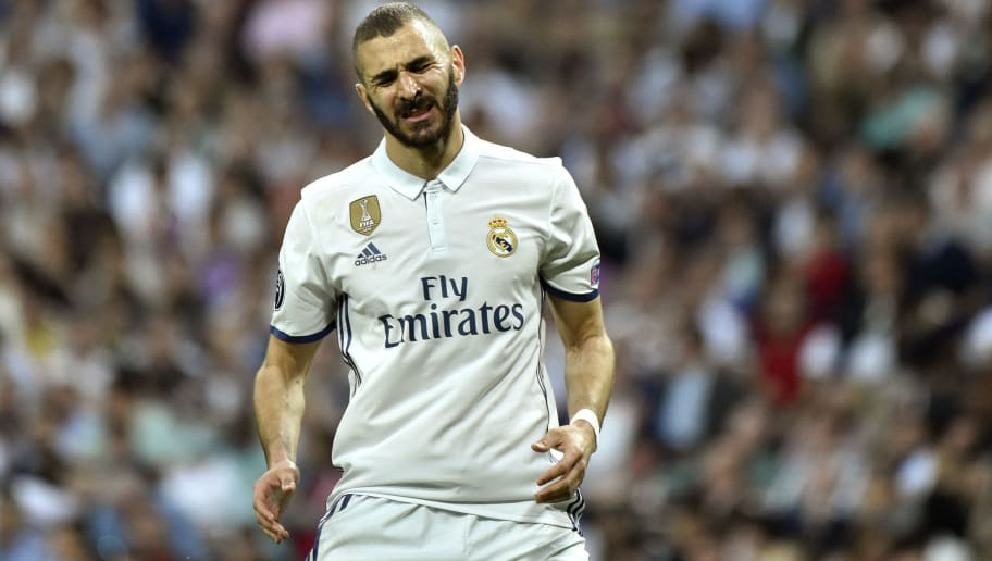 Real Madrid's French forward Karim Benzema gestures after missing a goal opportunity during the UEFA Champions League semi-final first leg football match Real Madrid vs Atletico de Madrid at the Santiago Bernabeu stadium in Madrid on May 2, 2017. Real Madrid won 3-0. / AFP PHOTO / GERARD JULIEN        (Photo credit should read GERARD JULIEN/AFP/Getty Images)