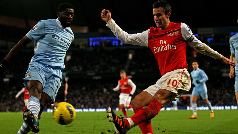 MANCHESTER, ENGLAND - DECEMBER 18:   Kolo Toure of Manchester City blocks the attempt on goal of Robin van Persie of Arsenal during the Barclays Premier League match between Manchester City and Arsenal at the Etihad Stadium on December 18, 2011 in Manchester, England.  (Photo by Clive Brunskill/Getty Images)