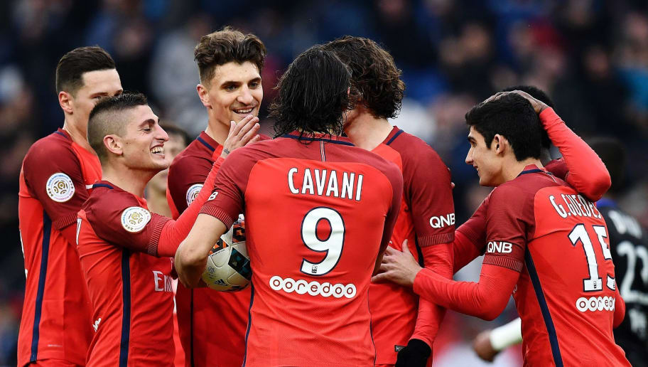 Paris Saint-Germain's Uruguayan forward Edinson Cavani is congratuled by teammates after scoring a goal during the French L1 football match between Paris Saint-Germain and Bastia at the Parc des Princes stadium in Paris, on May 6, 2017. / AFP PHOTO / FRANCK FIFE        (Photo credit should read FRANCK FIFE/AFP/Getty Images)