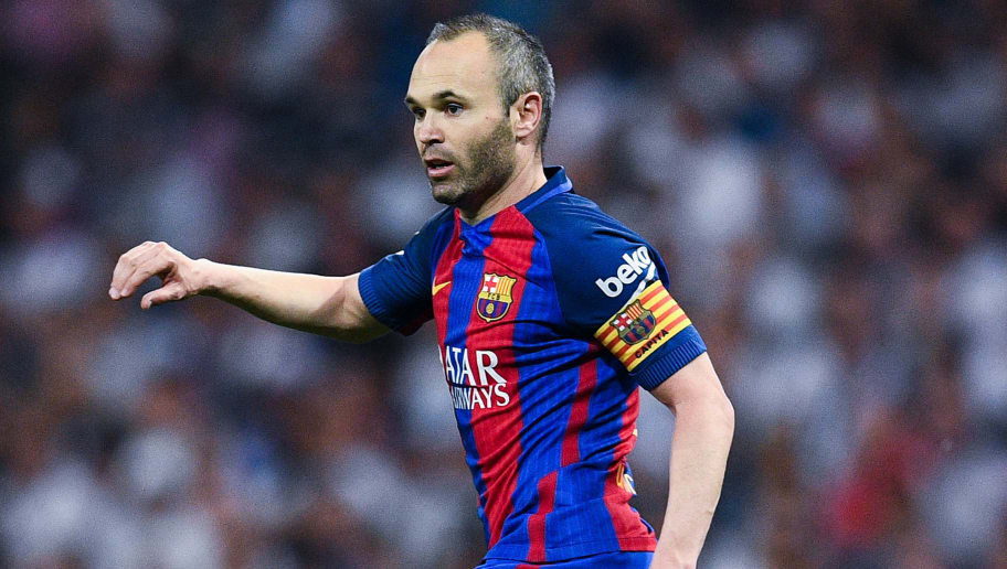 MADRID, SPAIN - APRIL 23:  Andres Iniesta of FC Barcelona runs with the ball during the La Liga match between Real Madrid CF and FC Barcelona at the Santiago Bernabeu stadium on April 23, 2017 in Madrid, Spain.  (Photo by David Ramos/Getty Images)