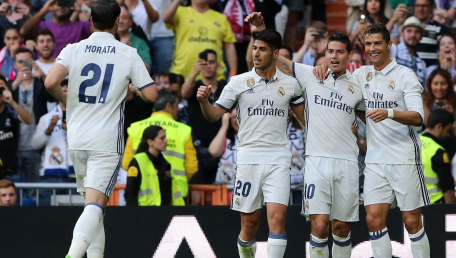 Real Madrid's Portuguese forward Cristiano Ronaldo (R) celebrates a goal with Real Madrid's Colombian midfielder James Rodriguez (2R) and Real Madrid's midfielder Marco Asensio (3R) during the Spanish league football match Real Madrid CF vs Sevilla FC at the Santiago Bernabeu stadium in Madrid on May 14, 2017. / AFP PHOTO / CESAR MANSO        (Photo credit should read CESAR MANSO/AFP/Getty Images)