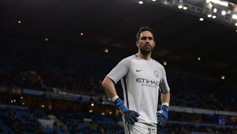 Manchester City's Chilean goalkeeper Claudio Bravo stands in his goal during the FA Cup fifth round replay football match between Manchester City and Huddersfield Town at the Etihad Stadium in Manchester, north west England, on March 1, 2017. Manchester City won the match 5-1. / AFP PHOTO / Oli SCARFF / RESTRICTED TO EDITORIAL USE. No use with unauthorized audio, video, data, fixture lists, club/league logos or 'live' services. Online in-match use limited to 75 images, no video emulation. No use in betting, games or single club/league/player publications.  /         (Photo credit should read OLI SCARFF/AFP/Getty Images)