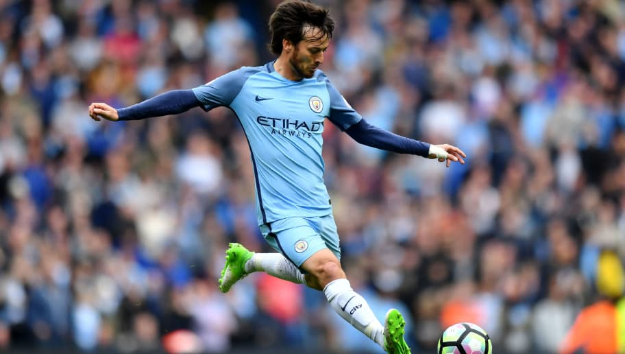 Manchester City's Spanish midfielder David Silva plays the ball during the English Premier League football match between Manchester City and Leicester City at the Etihad Stadium in Manchester, north west England, on May 13, 2017. / AFP PHOTO / Anthony Devlin / RESTRICTED TO EDITORIAL USE. No use with unauthorized audio, video, data, fixture lists, club/league logos or 'live' services. Online in-match use limited to 75 images, no video emulation. No use in betting, games or single club/league/player publications.  /         (Photo credit should read ANTHONY DEVLIN/AFP/Getty Images)