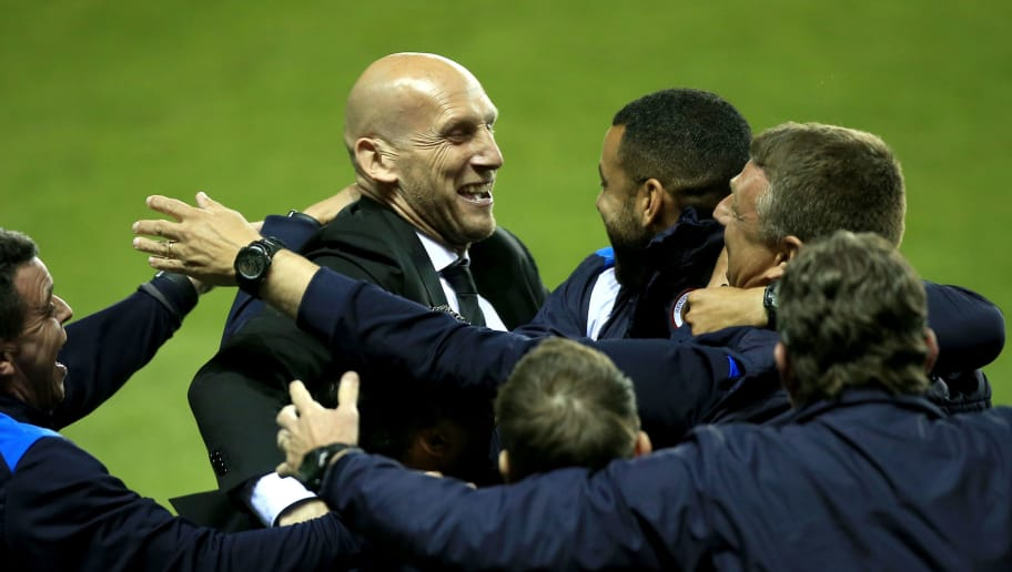 READING, ENGLAND - MAY 16: Jaap Stam, Manager of Reading celebrates after the Sky Bet Championship Play Off Second Leg match between Reading and Fulham at Madejski Stadium on May 16, 2017 in Reading, England.  (Photo by Ben Hoskins/Getty Images)