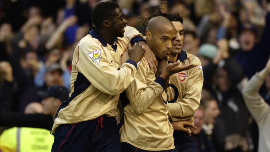 BIRMINGHAM - DECEMBER 26:  Thierry Henry of Arsenal celebrates scoring the winning goal during the FA Barclaycard Premiership match between West Bromwich Albion and Arsenal held on December 26, 2002 at The Hawthorns in Birmingham, England.  Arsenal won the match 2-1. (Photo by Shaun Botterill/Getty Images)