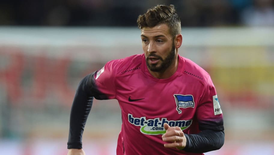 Berlin's defender Marvin Plattenhardt plays the ball during the German first division Bundesliga match between the FC Augsburg and Hertha BSC Berlin at the stadium in Augsburg, southern Germany, on November 19, 2016.  / AFP / CHRISTOF STACHE / RESTRICTIONS: DURING MATCH TIME: DFL RULES TO LIMIT THE ONLINE USAGE TO 15 PICTURES PER MATCH AND FORBID IMAGE SEQUENCES TO SIMULATE VIDEO. == RESTRICTED TO EDITORIAL USE == FOR FURTHER QUERIES PLEASE CONTACT DFL DIRECTLY AT + 49 69 650050         (Photo credit should read CHRISTOF STACHE/AFP/Getty Images)