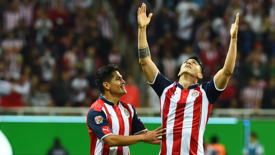 Alan Pulido (R) and Jesus Sanchez of Guadalajara celebrate after scoring against Veracruz during their Mexican Clausura 2017 tournament football match at Chivas stadium on March 18, 2017 in Guadalajara, Mexico / AFP PHOTO / HECTOR GUERRERO        (Photo credit should read HECTOR GUERRERO/AFP/Getty Images)