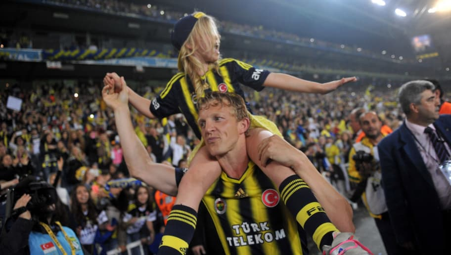 Fenerbahce's Dutch forward Dirk Kuyt celebrates his team's 2013-2014 champion title after the Turkish Super league football match between Fenerbahce and Caykur Rizespor at the Sukru Saracoglu Stadium in Istanbul on April 27, 2014. The match ended on a draw 0-0.  AFP PHOTO / OZAN KOSE        (Photo credit should read OZAN KOSE/AFP/Getty Images)