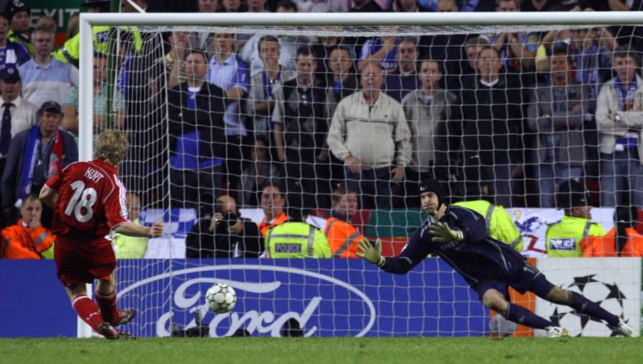 Liverpool, UNITED KINGDOM: Liverpool's Dutch forward Dirk Kuyt (L) scores the winning penalty past Chelsea's Czech goalkeeper Petr Cech to win the European Champions League semi final second leg football match at Anfield, Liverpool, north west England, 01 May 2007. Five-time champions Liverpool reached the Champions League final 01 May after beating Chelsea 4-1 on penalties after the tie ended 1-1 on aggregate. AFP PHOTO / PAUL ELLIS (Photo credit should read PAUL ELLIS/AFP/Getty Images)