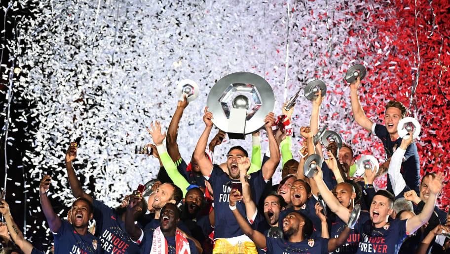 Monaco players celebrate at the end of their last French L1 football match Monaco (ASM) vs St Etienne (ASSE)  on May 17, 2017 at the 'Louis II Stadium' in Monaco. Monaco on May 17 won their first French league title in 17 years.  / AFP PHOTO / BORIS HORVAT        (Photo credit should read BORIS HORVAT/AFP/Getty Images)