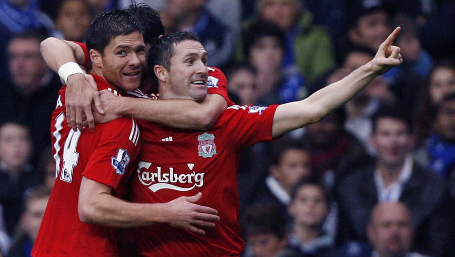 Liverpool's Spanish midfielder Xabi Alonso (L) celebrates scoring with team mate Republic Of Ireland Striker Robbie Keane (R) during their Premier League match against Chelsea at Stamford Bridge, London, on October 26, 2008. AFP PHOTO / Glyn Kirk  Mobile and website use of domestic English football pictures are subject to obtaining a Photographic End User Licence from Football DataCo Ltd Tel : +44 (0) 207 864 9121 or e-mail accreditations@football-dataco.com - applies to Premier and Football League matches (Photo credit should read GLYN KIRK/AFP/Getty Images)