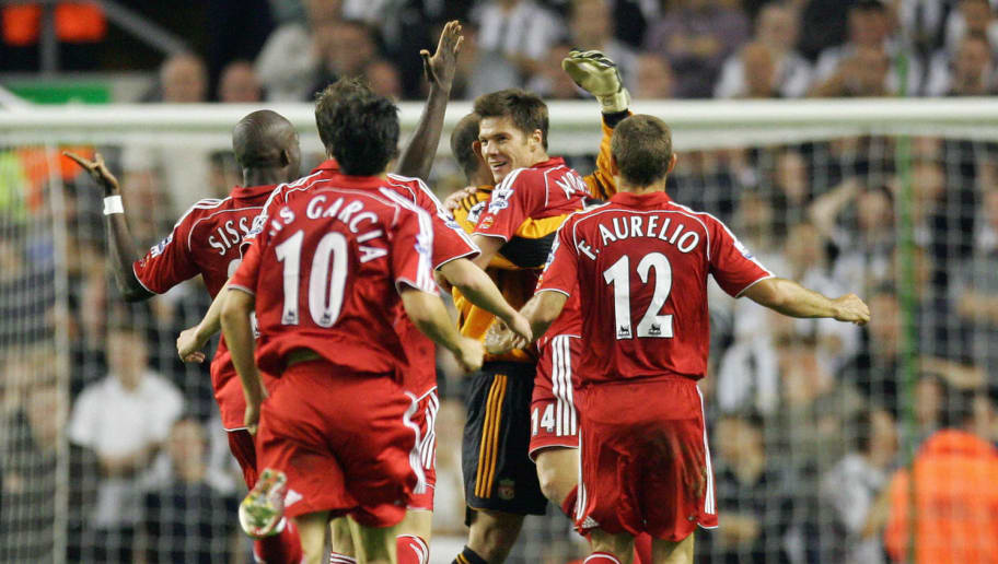 Liverpool, UNITED KINGDOM:  Liverpool's Xabi Alonso (C) celebrates scoring a long range goal against Newcastle United during their English Premiership football match at Anfield, Liverpool, 20 Septmeber 2006. AFP PHOTO/PAUL ELLIS Mobile and website use of domestic English football pictures subject to subscription of a license with Football Association Premier League (FAPL) tel : +44 207 298 1656. For newspapers where the football content of the printed and electronic versions are identical, no licence is necessary.  (Photo credit should read PAUL ELLIS/AFP/Getty Images)