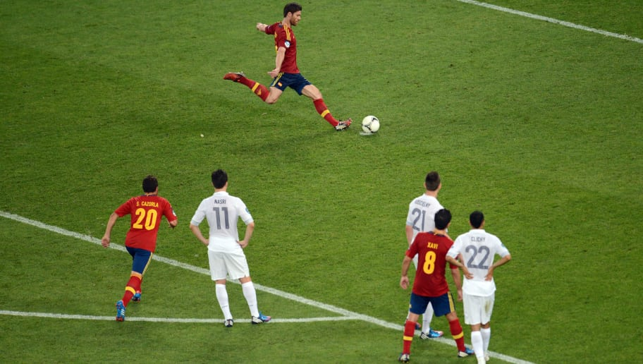 DONETSK, UKRAINE - JUNE 23:  Xabi Alonso of Spain scores the second goal from the penalty spot during the UEFA EURO 2012 quarter final match between Spain and France at Donbass Arena on June 23, 2012 in Donetsk, Ukraine.  (Photo by Jasper Juinen/Getty Images)