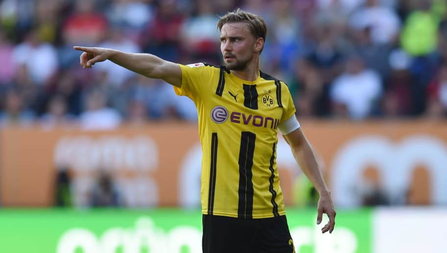 Dortmund's defender Marcel Schmelzer gestures during the German first division Bundesliga football match between FC Augsburg and Borussia Dortmund on May 13, 2017 in Augsburg, southern Germany.  / AFP PHOTO / Christof STACHE / RESTRICTIONS: DURING MATCH TIME: DFL RULES TO LIMIT THE ONLINE USAGE TO 15 PICTURES PER MATCH AND FORBID IMAGE SEQUENCES TO SIMULATE VIDEO. == RESTRICTED TO EDITORIAL USE == FOR FURTHER QUERIES PLEASE CONTACT DFL DIRECTLY AT + 49 69 650050         (Photo credit should read CHRISTOF STACHE/AFP/Getty Images)
