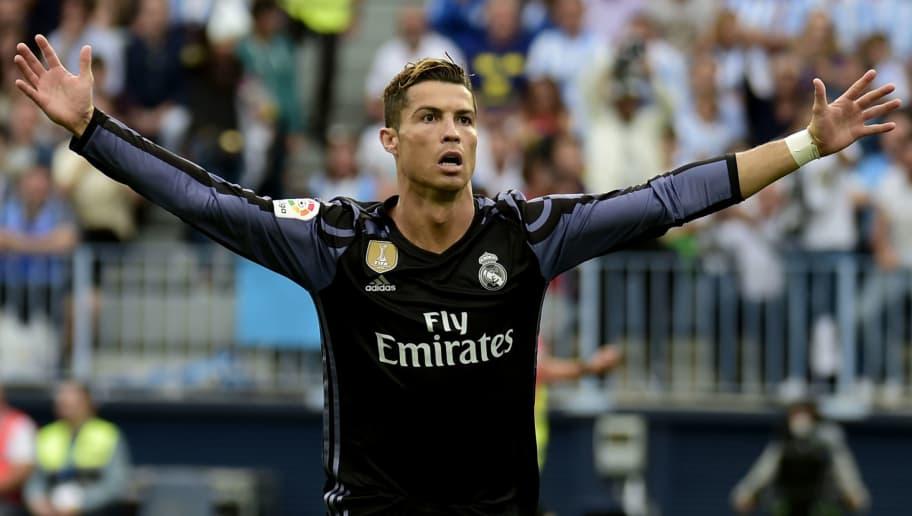Real Madrid's Portuguese forward Cristiano Ronaldo celebrates after scoring during the Spanish league football match Malaga CF vs Real Madrid CF  at La Rosaleda stadium in Malaga on May 21, 2017. / AFP PHOTO / JOSE JORDAN        (Photo credit should read JOSE JORDAN/AFP/Getty Images)