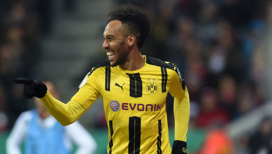 Dortmund's Gabonese striker Pierre-Emerick Aubameyang celebrates after the second goal for Dortmund during the German Cup DFB Pokal semifinal football match between FC Bayern Munich and BVB Borussia Dortmund in Munich, on April 26, 2017. / AFP PHOTO / Christof STACHE / RESTRICTIONS: ACCORDING TO DFB RULES IMAGE SEQUENCES TO SIMULATE VIDEO IS NOT ALLOWED DURING MATCH TIME. MOBILE (MMS) USE IS NOT ALLOWED DURING AND FOR FURTHER TWO HOURS AFTER THE MATCH. == RESTRICTED TO EDITORIAL USE == FOR MORE INFORMATION CONTACT DFB DIRECTLY AT +49 69 67880   /         (Photo credit should read CHRISTOF STACHE/AFP/Getty Images)