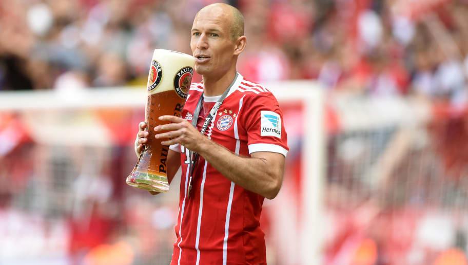 1223dacff Bayern Munich s Dutch midfielder Arjen Robben drinks beer during the  celebration of the German football Bundesliga