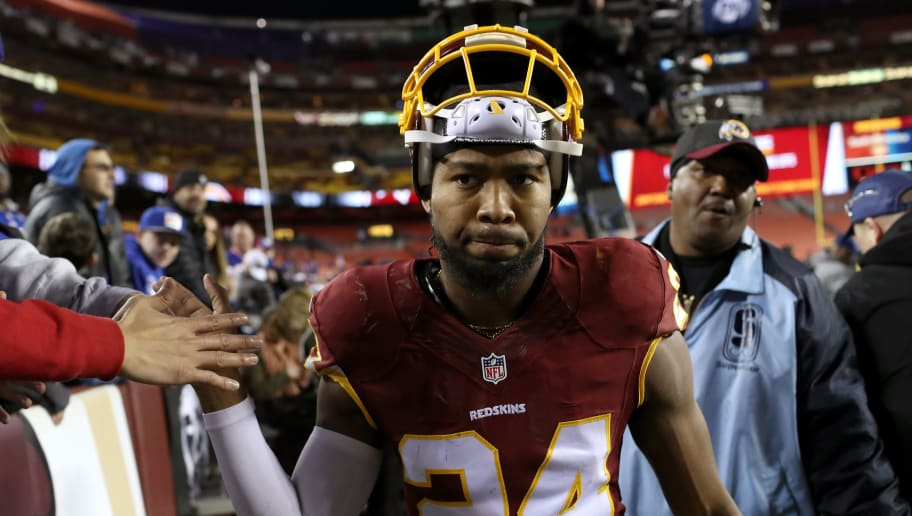 LANDOVER, MD - JANUARY 01: Cornerback Josh Norman #24 of the Washington Redskins high fives fans after the New York Giants defeated the Washington Redskins 19-10 at FedExField on January 1, 2017 in Landover, Maryland. (Photo by Rob Carr/Getty Images)