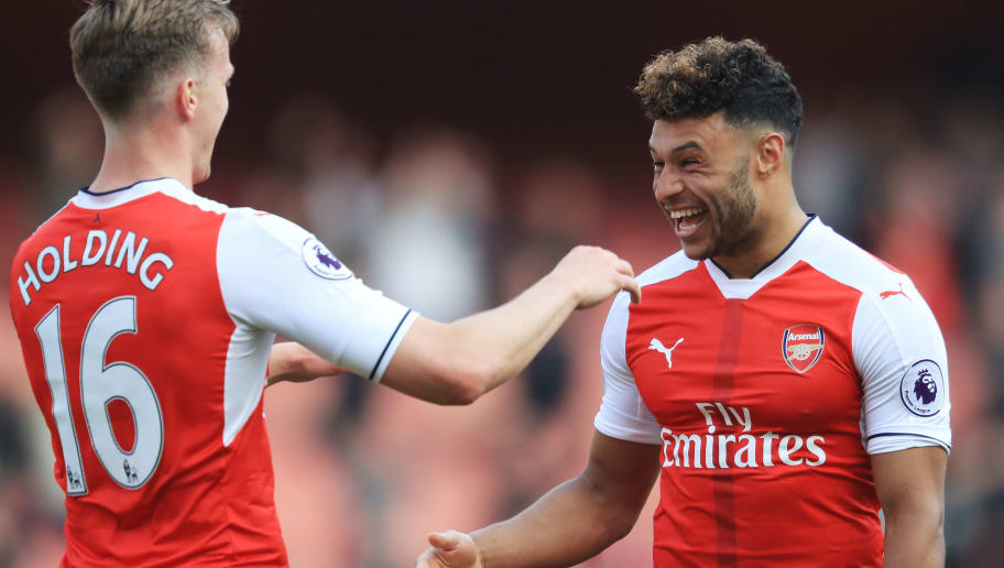 LONDON, ENGLAND - MAY 07: Rob Holding of Arsenal and Alex Oxlade-Chamberlain of Arsenal celebrate after the Premier League match between Arsenal and Manchester United at the Emirates Stadium on May 7, 2017 in London, England.  (Photo by Richard Heathcote/Getty Images)