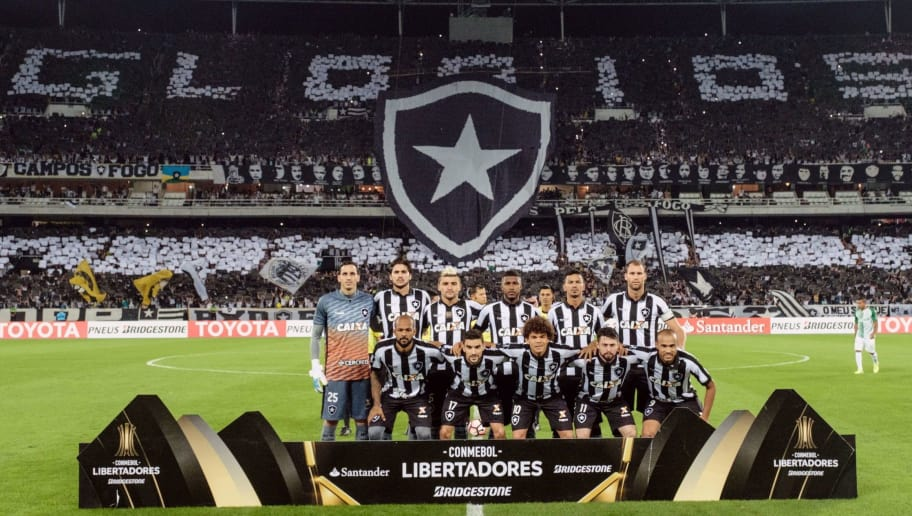 Players of Brazil's Botafogo pose before the Copa Libertadores 2017 football match against Colombia's Atletico Nacional at the Nilton Santos Olympic 'Engenhao' stadium in Rio de Janeiro, Brazil, on May 18, 2017. / AFP PHOTO / YASUYOSHI CHIBA        (Photo credit should read YASUYOSHI CHIBA/AFP/Getty Images)