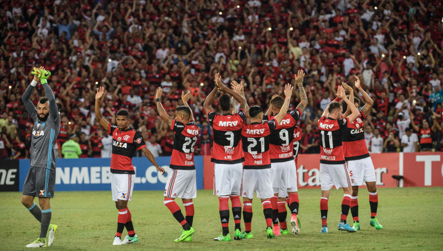 Players of Brazil's Flamengo react to fans before their Copa Libertadores 2017 football match against Chile's Universidad Catolica at Maracana stadium in Rio de Janeiro, Brazil, on May 3, 2017.  / AFP PHOTO / YASUYOSHI CHIBA        (Photo credit should read YASUYOSHI CHIBA/AFP/Getty Images)
