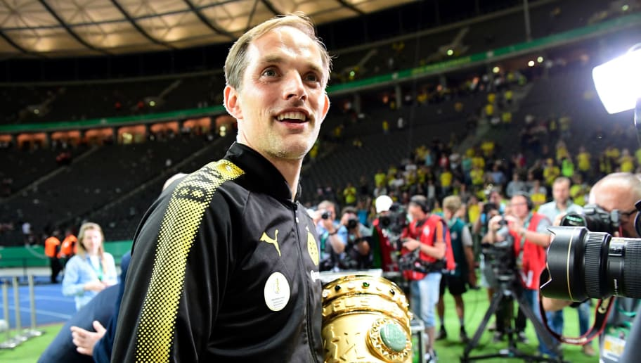 Dortmund's head coach Thomas Tuchel celebrates with the trophy after the German Cup (DFB Pokal) final football match Eintracht Frankfurt v BVB Borussia Dortmund at the Olympic stadium in Berlin on May 27, 2017. / AFP PHOTO / Tobias SCHWARZ / RESTRICTIONS: ACCORDING TO DFB RULES IMAGE SEQUENCES TO SIMULATE VIDEO IS NOT ALLOWED DURING MATCH TIME. MOBILE (MMS) USE IS NOT ALLOWED DURING AND FOR FURTHER TWO HOURS AFTER THE MATCH. == RESTRICTED TO EDITORIAL USE == FOR MORE INFORMATION CONTACT DFB DIRECTLY AT +49 69 67880   /         (Photo credit should read TOBIAS SCHWARZ/AFP/Getty Images)