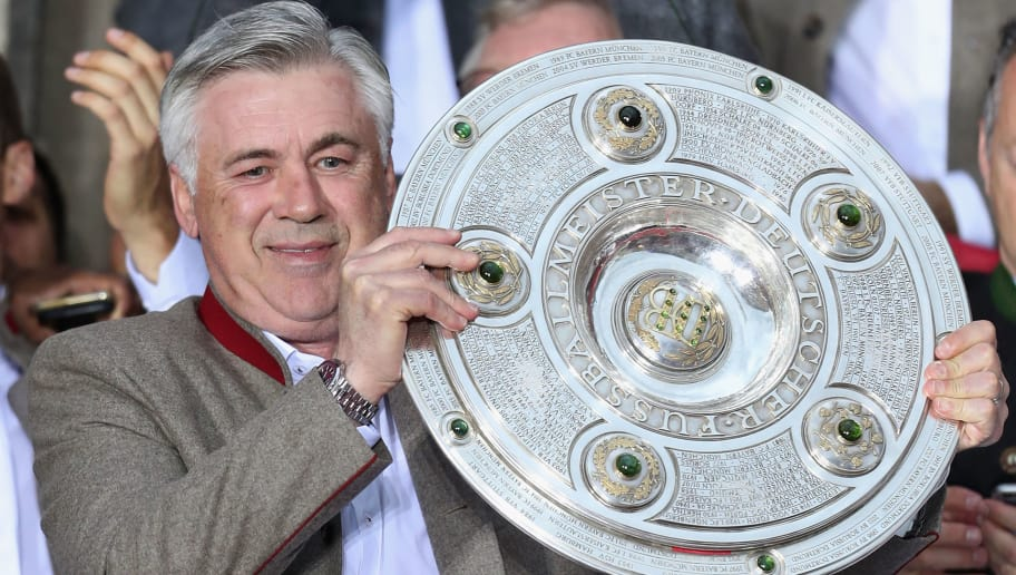 MUNICH, GERMANY - MAY 20:  Team coach Carlo Ancelotti of Bayern Muenchen celebrates with teammates and staff winning the 67th German Championship title on the town hall balcony at Marienplatzon May 20, 2017 in Munich, Germany.  (Photo by Alexandra Beier/Bongarts/Getty Images)