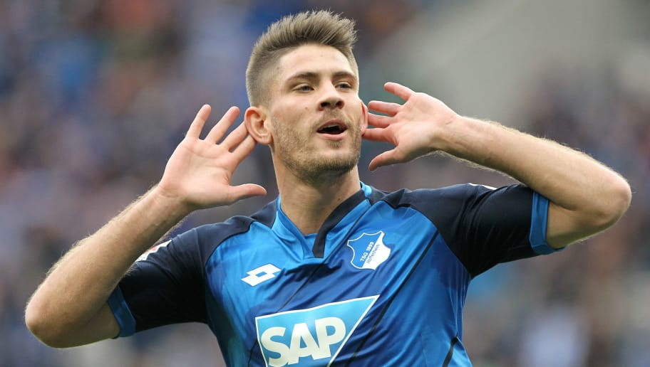 Hoffenheim's Croatian forward Andrej Kramaric celebrates scoring the 3-2 during the German First division Bundesliga football match between TSG Hoffenheim and FC Ingolstadt 04 in Sinsheim, Germany, on March 4, 2017. / AFP PHOTO / Daniel ROLAND / RESTRICTIONS: DURING MATCH TIME: DFL RULES TO LIMIT THE ONLINE USAGE TO 15 PICTURES PER MATCH AND FORBID IMAGE SEQUENCES TO SIMULATE VIDEO. == RESTRICTED TO EDITORIAL USE == FOR FURTHER QUERIES PLEASE CONTACT DFL DIRECTLY AT + 49 69 650050         (Photo credit should read DANIEL ROLAND/AFP/Getty Images)