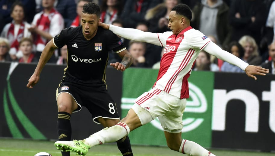 Lyon's French midfielder Coretin Tolisso (L) vies with Ajax defender Kenny Tete (R) vie during UEFA Europa League semi-final, first leg, Ajax Amsterdam v Olympique Lyonnais (OL) on May 3, 2017 in Amsterdam.  / AFP PHOTO / JEAN-PHILIPPE KSIAZEK        (Photo credit should read JEAN-PHILIPPE KSIAZEK/AFP/Getty Images)