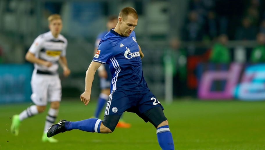 MOENCHENGLADBACH, GERMANY - MARCH 04:  Holger Badstuber of Schalke runs with the ball during the Bundesliga match between Borussia Moenchengladbach and FC Schalke 04 at Borussia-Park on March 4, 2017 in Moenchengladbach, Germany.  (Photo by Christof Koepsel/Bongarts/Getty Images)
