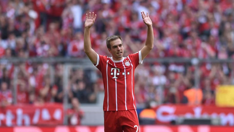 Bayern Munich's defender Philipp Lahm waves after his last Bundesliga football match after the German first division Bundesliga football match FC Bayern Munich vs SC Freiburg in the stadium of Munich, southern Germany, on May 20, 2017. / AFP PHOTO / Christof STACHE        (Photo credit should read CHRISTOF STACHE/AFP/Getty Images)
