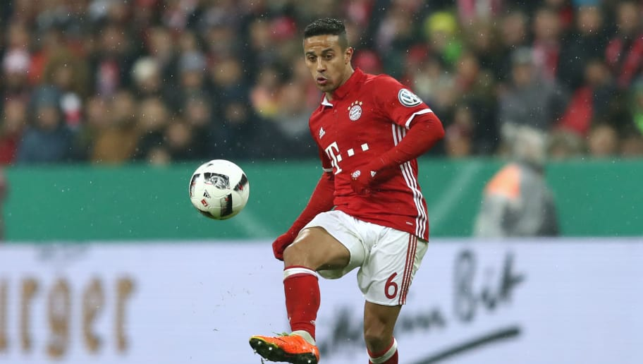 MUNICH, GERMANY - APRIL 26:  Thiago of Muenchen runs with the ball during the DFB Cup semi final match between FC Bayern Muenchen and Borussia Dortmund at Allianz Arena on April 26, 2017 in Munich, Germany.  (Photo by Alexander Hassenstein/Bongarts/Getty Images)