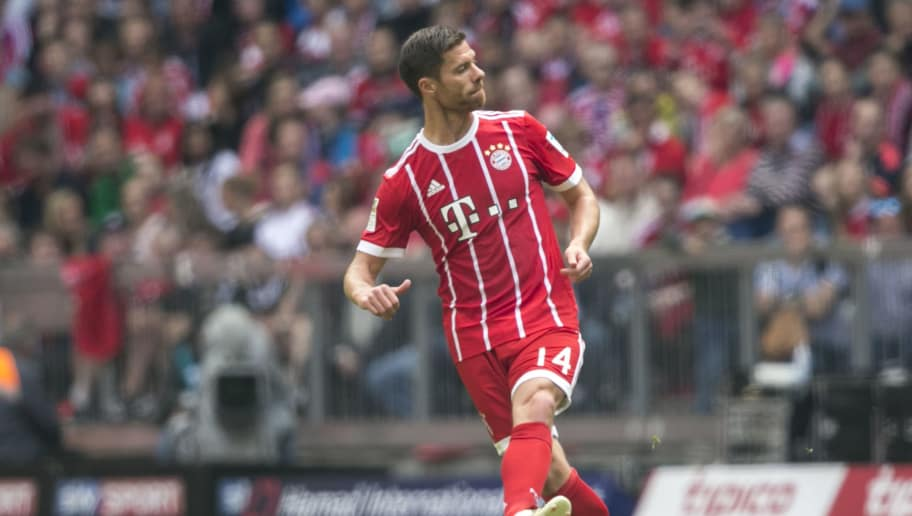 MUNICH, GERMANY - MAY 20: Xabi Alonso of FC Bayern Muenchen in action during the Bundesliga match between Bayern Muenchen and SC Freiburg at Allianz Arena on May 20, 2017 in Munich, Germany. (Photo by Jan Hetfleisch/Getty Images for MAN)