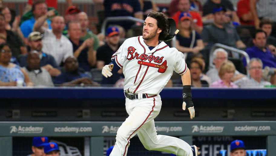 ATLANTA, GA - MAY 03: Dansby Swanson #7 of the Atlanta Braves loses his helmet as he runs home to score during the fourth inning against the New York Mets at SunTrust Park on May 3, 2017 in Atlanta, Georgia. (Photo by Daniel Shirey/Getty Images)