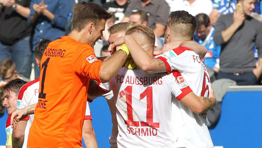 Augsburg's players react after during the German first division football match between TSG Hoffenheim 1899 and FC Augsburg on May 20, 2017 in Sinsheim, southern Germany. / AFP PHOTO / Amelie QUERFURTH / RESTRICTIONS: DURING MATCH TIME: DFL RULES TO LIMIT THE ONLINE USAGE TO 15 PICTURES PER MATCH AND FORBID IMAGE SEQUENCES TO SIMULATE VIDEO. == RESTRICTED TO EDITORIAL USE == FOR FURTHER QUERIES PLEASE CONTACT DFL DIRECTLY AT + 49 69 650050         (Photo credit should read AMELIE QUERFURTH/AFP/Getty Images)